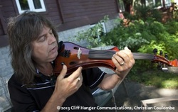Joel Derouin demonstrates his custom made violin for stage performances